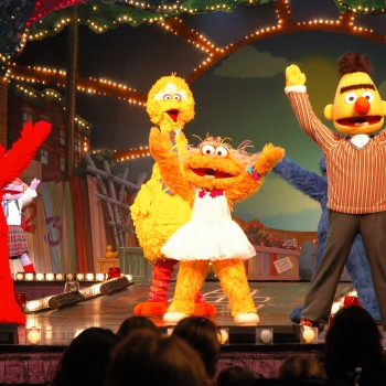 Elmo, Big Bird, and Bert from Sesame Street during a live show.