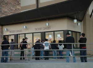 Arena box office with customers standing outside purchasing tickets.